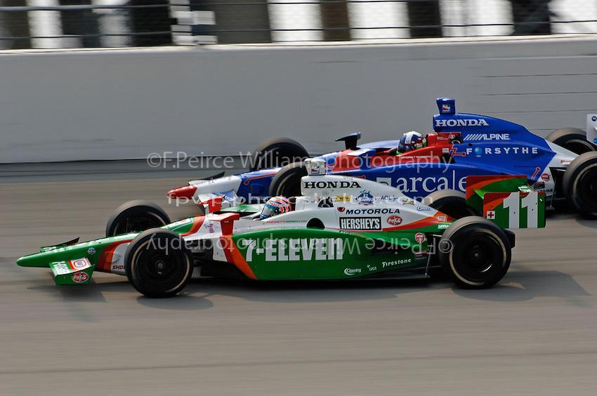 11 September, 2005, Joliet,IL,USA<br /> Tony Kanaan (11) races teammate Dario Franchitti.<br /> Copyright&copy;F.Peirce Williams 2005