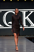 A model walks down the runway during the KQK  fashion show held during the Fashion and Design Festival  in downtown Montreal