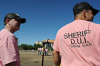 """Tempe, Arizona - Controversial Maricopa County sheriff Joe Arpaio -who bills himself as the """"toughest sheriff in America""""- sent out to the streets a new chain gang made up entirely of undocumented immigrants who have been convicted of drunken driving. According to the Maricopa County Sheriff's Office (MCSO), the new chain gang attempts to send a strong message about the hazards of driving under the influence (DUI). Inmates who are part of the chain gang are immigrants living illegally in the United States. They were previously arrested for driving a vehicle under the influence of alcohol. All are serving sentences for DUI offenses committed while driving in Maricopa County. Photo by Eduardo Barraza © 2011"""