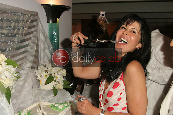 Maria Conchita Alonso has a taste of her cake<br /> at Maria Conchita Alonso's Surprise Birthday Party, Private Residence, Los Angeles, CA 06-25-05<br /> David Edwards/DailyCeleb.Com 818-249-4998<br /> EXCLUSIVE