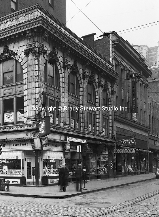 Pittsburgh PA:  View of corner of Wood Street and Diamond Street - 1935.  Nearby stores include; Dimling's Candy, Ellis Billiards, Rosenthal Dentist, and W.T. Grants