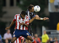 Alan Gordon of Earthquakes fights for the ball in the air against Rauwshan McKenzie of Chivas USA during the game at Buck Shaw Stadium in Santa Clara, California on September 2nd, 2012.   San Jose Earthquakes defeated Chivas USA, 4-0.