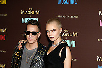 Designer Jeremy Scott and model Cara Delevigne arrive at the Magnum X Moschino party during the 70th Annual Cannes Film Festival at Plage l'Ondine in Cannes, France, on 18 May 2017. Photo: Hubert Boesl - NO WIRE SERVICE · Photo: Hubert Boesl/dpa /MediaPunch ***FOR USA ONLY***
