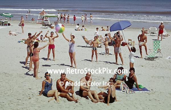 People enjoying at beach in Wildwood, New Jersey. 1960's