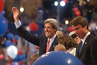 BOSTON, MA - July 29, 2004: Democratic Presidential Nominee John Kerry waves to the crowd following his nomination acceptance speech. Vice Presidential nominee John Edwards stands in the foreground at the FleetCenter in Boston, Massachusetts.