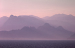 Huge, hazy mountain range over Mediterranean sea