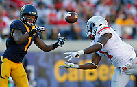 Ohio State Buckeyes cornerback Bradley Roby (1) breaks up a pass for California Golden Bears wide receiver Bryce Treggs (1) in the 2nd quarter at Memorial Stadium in Berkeley, California on September 14, 2013.  (Dispatch photo by Kyle Robertson)