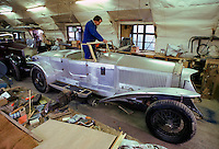 Vintage Rolls Royce car in process of paint spraying during restoration at Ashton Keynes Vintage Restorations in Wiltshire, UK