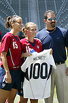 24 July 2005: U.S. forward Tiffeny Milbrett (center) poses with her commemmorative jersey with teammate Kate Markgraf (left) and U.S. Women's National Team General Manager Nils Krumins during a pregame ceremony to celebrate Milbrett's 100th international goal. The United States defeated Iceland 3-0 at the Home Depot Center in Carson, California in a Women's International Friendly soccer match..