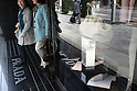 Apr 19, 2010 - Tokyo, Japan - Shoppers leave a Prada store in the Ginza district of Tokyo, Japan, on April 19, 2010. Rina Bovrisse, a former senior Retail manager at PRADA Japan, is suing the Italian fashion designer after she was placed on involuntary leave last November and she was asked to 'eliminate' around 15 managerial staff who was categorized as 'old, fat, ugly, disgusting or not having the Prada look'.