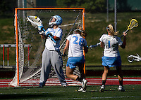 Logan Ripley (48) of North Carolina makes a a save on the shot of Shannon McHugh (12) of Cornell at St. Stephens and St. Agnes High School in Alexandria, VA.  North Carolina defeated Cornell, 13-7.