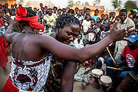 Two women dance during an initiation ceremony for a new witchdoctor.