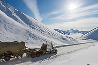 Truck drives the James Dalton Highway through Atigun Pass, in Alaska's Arctic.