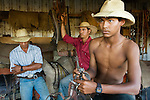 Cowboys or vaqueros prepare for a horseback ride at the Fazenda Rio Negro.