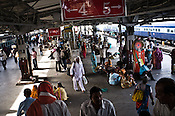 Travellers seen at the busy New Delhi Railway Station in New Delhi, India. Photo: Sanjit Das/Panos