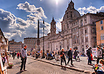 Tourists and locals mix on a bright, sunny weekend at the weekend art fair in the Piazza Navona (Rome, Italy).
