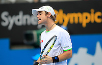 Blaz Kavcic of Slovenia reacts after missing a shot against Bernard Tomic of Australia during their men's singles match at the Sydney International tennis tournament, Jan. 8, 2014.  IMAGE RESTRICTED TO EDITORIAL USE ONLY. Photo by Daniel Munoz/VIEWpress