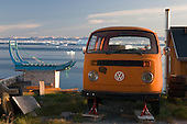 Dog sled and a Volkswagon van on jacks, Greenland