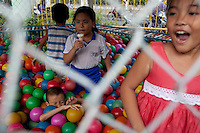 Thang, 9,  plays at a park nearby the hospital while waiting for his heart surgery in Ho Chi Minh City, Vietnam...---..Nguyen Van Thang is nine-years-old and just finished second grade. He lives in the coastal town of Nha Trang with his mother, grandmother, and 10-month-old brother. Thang's father, Bui Van Tri, spends much of his time away from his family, as he is a fisherman and works up and down the coastline. His income is about 400,000VND (~$23USD) per month; however, this salary is seasonal and there are months when he earns nothing at all. ..Thang's mother, Nguyen Thi Bach Tuyet, is 31-years-old and is a housewife. She cannot work as she must look after Thang, his brother, and his grandmother. Therefore, the family of five is solely dependent on Thang's father's income. The family lives in a lean-to extension of Thang's uncle's house that is just eight square meters with a tin roof, cement floor, and brick walls...Thang suffers from Ventricular Septal Defect (VSD), a common congenital heart defect (CHD) that occurs when there is a hole in the wall between the right and left ventricles of the heart. Symptoms of VSD include shortness of breath, fast heartbeats, loss of appetite, poor weight gain, chest pain, and discolored blue skin. In addition, other areas of the child's development such as physical growth and brain development are affected if VSD is left untreated, and the child also has a high chance of developing irreversible pulmonary hypertension...Thang was diagnosed with VSD when he was just two-months-old. He and Tuyet, his mother, made the arduous 10-hour trek from Nha Trang to the Heart Institute in Ho Chi Minh City at least five times over the course of his life, and the diagnosis was always the same: Surgery, or else he would die. Lifesaving surgery, however, was out of the question as it cost $3,100USD--a sum that was beyond anything Thang's family could scrape together. After each hospital visit Tuyet would make the long bus journey back to Nha
