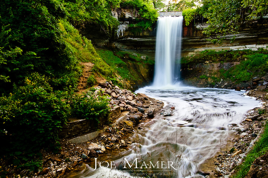 """53 foot tall Minnehaha falls on Minnehaha Creek. The translation of the name is """"curling water"""" or """"waterfall"""". The name comes from the Dakota language elements mni, meaning water, and haha, meaning waterfall."""