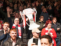 A Lincoln City fan waves a replica trophy to celebrate promotion<br /> <br /> Photographer Andrew Vaughan/CameraSport<br /> <br /> Vanarama National League - Lincoln City v Macclesfield Town - Saturday 22nd April 2017 - Sincil Bank - Lincoln<br /> <br /> World Copyright &copy; 2017 CameraSport. All rights reserved. 43 Linden Ave. Countesthorpe. Leicester. England. LE8 5PG - Tel: +44 (0) 116 277 4147 - admin@camerasport.com - www.camerasport.com