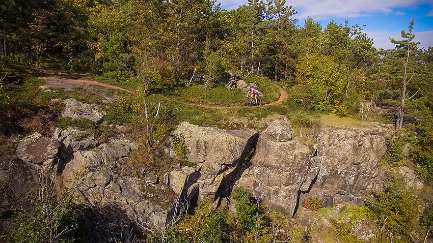 STILL FROM VIDEO 2700x1518<br /> Drone shot of mountain biker on the Panorama Trail of the RAMBA trail network in Negaunee and Ishpeming Michigan.