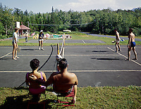 People playing paddle ball in their bathing suits. 1960's.