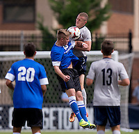 Zabarle Kollie (23) of Creighton goes up for a header with Cole Seiler (14) of Georgetown during the game at Shaw Field on the campus of the Georgetown University in Washington, DC.  Georgetown tied Creighton, 0-0, in double overtime.
