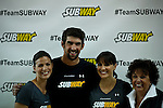 "Olympic medalist Michael Phelps poses for a picture with members of his family L_R Whitney, Hilary and his mom Debbie Phelps while they attend a event called ""Official Training Restaurant of the Phelps Family"" to support his sister Whitney as she runs the ING New York City Marathon on November 4.  the event was organized by the food company ""Subway"" in New York, United States. 15/10/2012. Photo by VIEWpress."