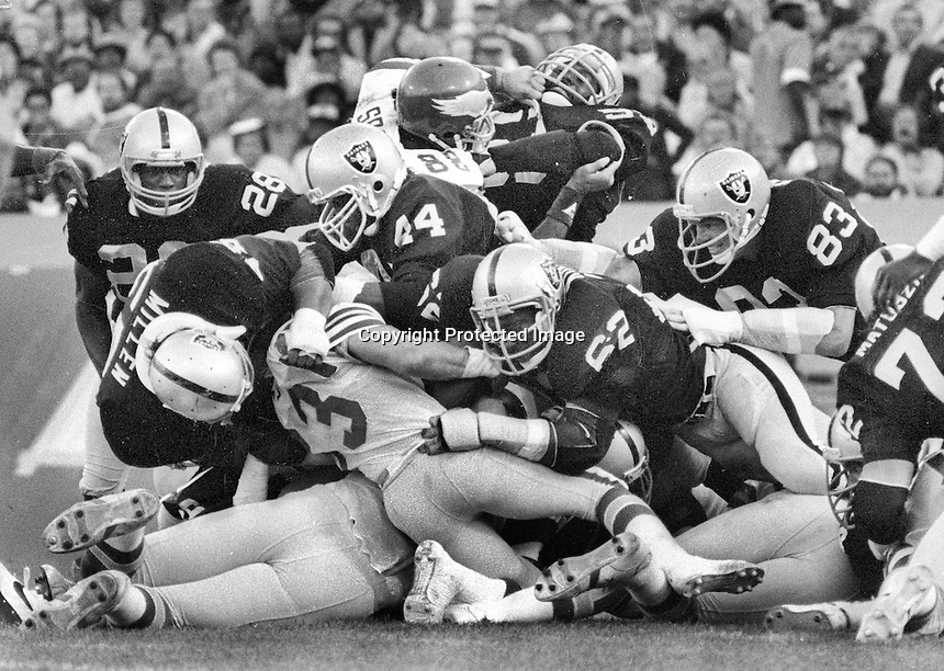 Oakland Raider defense stopped Philadelphia Eagle runner Louie Giammona on the goal line. Raiders, Matt millen, Reggie Kinlaw, Burgess Owens, and Ted Hendricks. (1980 photo/Ron Riesterer)