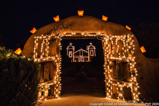 Traditional Christmas lights, known as faralitos or luminarias, decorate the Santurio de Chimayo, a colorful church in the small northern New Mexico village of Chimayo.