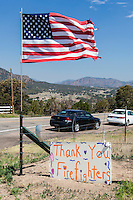 Multiple wild fires were burning around Colorado when this handmade sign thanking firefighters appeared  along Highway 50 near the Royal Gorge, site of one of those fires.
