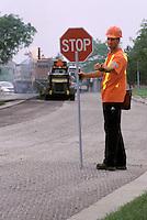 Flagman on Road Resurfacing Project