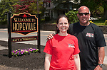 WATERBURY,  CT-051917JS04-Ray and Shannon Squatriglia, owners of Rays Automotive on Baldwin Street in Waterbury, recently installed a sign welcoming folks to the Hopeville section of town.  Jim Shannon Republican-American