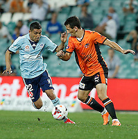 Brisbane Roar Liam Miller (R) and Sydney FC Ali Abbas during their A-League match in Sydney, March 14, 2014. Photo by Daniel Munoz/VIEWPRESS EDITORIAL USE ONLY