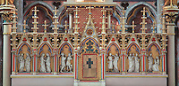 Altarpiece sculpted in wood and stone, 1862, with 6 new testament scenes, by the Duthoit brothers, in the apsidial Chapelle de la Vierge, or Chapelle de la Petite Paroisse, restored under Viollet-le-Duc in the 19th century, in the Basilique Cathedrale Notre-Dame d'Amiens or Cathedral Basilica of Our Lady of Amiens, built 1220-70 in Gothic style, Amiens, Picardy, France. The chapel was restored under Viollet le Duc in the 19th century in 13th century style. Amiens Cathedral was listed as a UNESCO World Heritage Site in 1981. Picture by Manuel Cohen