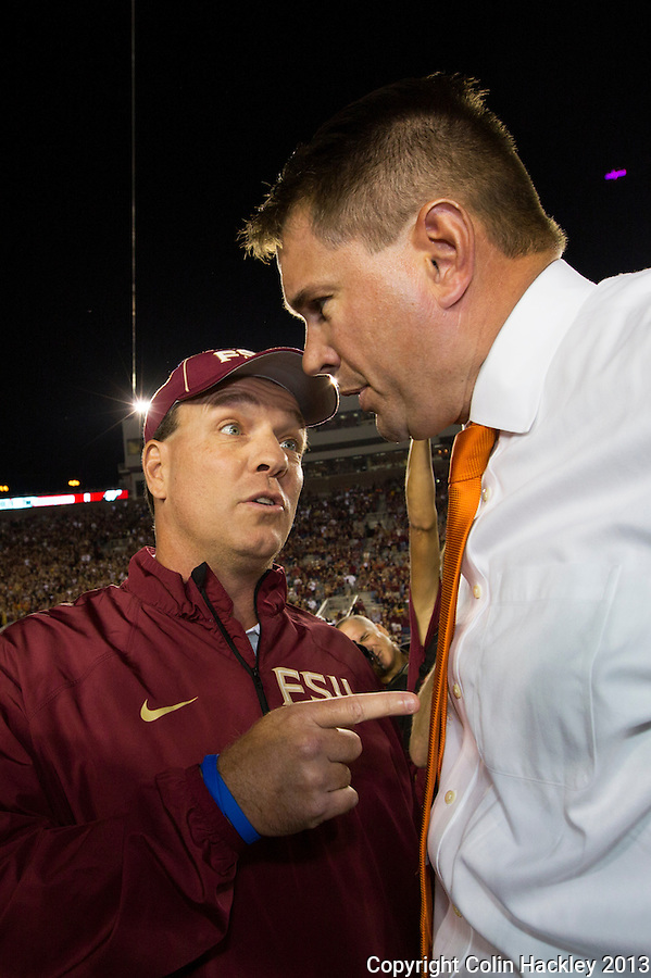 TALLAHASSEE, FL 11/2/13-FSU-MIAMI110213CH-Florida State Head Coach Jimbo Fisher, left, talks with University of Miami Heach Coach Al Golden prior to the game Saturday at Doak Campbell Stadium in Tallahassee. <br /> COLIN HACKLEY PHOTO