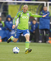 Seattle Sounders FC midfielder Osvaldo Alonso passes the ball during play against the L.A. Galaxy at Qwest Field in Seattle Tuesday March 15, 2011. The Galaxy won the game 1-0.