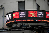 A foreign currency exchange store in Midtown Manhattan in New York shows their rates of the Chinese Renminbi to the U.S. Dollar on Friday, January 27, 2017. (© Richard B. Levine)