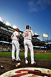 30 September 2009: Washington Nationals' outfielder Josh Willingham (right) stands in the on deck circle with teammate Adam Dunn during a pitching change by the New York Mets at Nationals Park in Washington, DC. The Nationals rallied in the bottom of the 9th inning on Justin Maxwell's walk-off Grand Slam to win 7-4 and sweep the Mets 3-game series capping the Nationals' 2009 home season. Mandatory Credit: Ed Wolfstein Photo