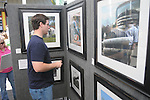 David Reeves looks at photographs at the Double Decker Arts Festival in Oxford, Miss. on Sunday, April 25, 2010.