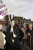 Protesters gather in the market square in the Northamptonshire town of Rothwell where conservative Party leader, Michael Howard, is due to speak during his elction campaign.