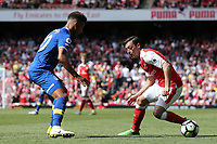 Alexis Sanchez of Arsenal and Mason Holgate of Everton during Arsenal vs Everton, Premier League Football at the Emirates Stadium on 21st May 2017