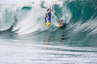 02 May, 2005 : - - (Teahupoo Tahiti): In one death defying moment the heaving left hander of Teahupoo has displayed its full lethal potential to the worlds best surfers in town for the Billabong Pro Tahiti  by serving up monster 5-6m (12-15ft) waves.<br />  <br /> As the world&rsquo;s top 45 men and 17 women begun arriving at the small Tahitian village  a major pulse in Pacific Ocean energy saw the heaving left hander of Teahupoo (Cheo-poo) live up to its reputation as one of the world&rsquo;s heaviest waves.<br />  <br /> In full view of the world&rsquo;s elite including three times world champion Andy Irons (Haw), younger brother Bruce, big wave charger Shane Dorian (Haw) and the surfing paparazzi, Tahitian charger Raimana Van Bastoloer went within an inch of losing his life in one of the most radical surfing near misses ever witnessed. <br />  <br /> As the local goofy footer was towed into a 4m (12ft) morning set, his jet ski driver Reef Macintosh (Haw) was caught in the wave lip and unable to pull out, careering the ski directly over the pitching lip and into the path of Van Bastoloae. Pulling into the massive barreling wave, Van Bastoloae ducked at the last second, the abandoned jet ski narrowly missing his head before spearing straight into the shallow reef. Photo: joliphotos.com