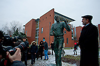 Photographers take a photo of the first ever life-size bronze statue of late Apple leader Steve Jobs with Gabor Bojar (R) head of Hungarian software company Graphisoft after the inauguration ceremony in Budapest, Hungary on December 21, 2011. ATTILA VOLGYI