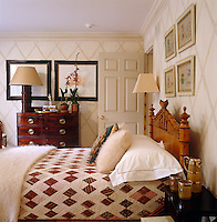 The walls in this bedroom are custom painted in a bamboo lattice pattern. In keeping with the theme the bed is vintage American faux bamboo and the bamboo floor lamp is a Moschino design