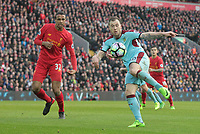 Burnley's Ashley Barnes volleys under pressure from Liverpool's Joel Matip but his effort flies high over the Liverpool goal<br /> <br /> Photographer Rich Linley/CameraSport<br /> <br /> The Premier League - Liverpool v Burnley - Sunday 12 March 2017 - Anfield - Liverpool<br /> <br /> World Copyright &copy; 2017 CameraSport. All rights reserved. 43 Linden Ave. Countesthorpe. Leicester. England. LE8 5PG - Tel: +44 (0) 116 277 4147 - admin@camerasport.com - www.camerasport.com