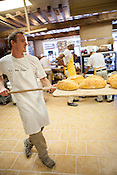 Cary, North Carolina - Saturday September 19, 2015 - Stephen Polzin removes fresh bread from the oven at La Farm Bakery Saturday September 19, 2015 in Cary, North Carolina.