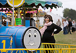 JAMES BOARDMAN / 07967642437.A heavily pregnant Natasha Kaplinsky watches friends children having fun on fair ground rides at Barcombe Mills Country Fair in East Sussex, 10 August 2008. *** MANDATORY BYLINE  JAMES BOARDMAN ***