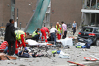 (July22,2010)Two men are treated for injuries received after a large vehicle bomb was detonated near the offices of Norwegian Prime Minister Jens Stoltenberg on 22 July 2011. Although Stoltenberg was reportedly unharmed the blast resulted in several injuries and deaths. <br />